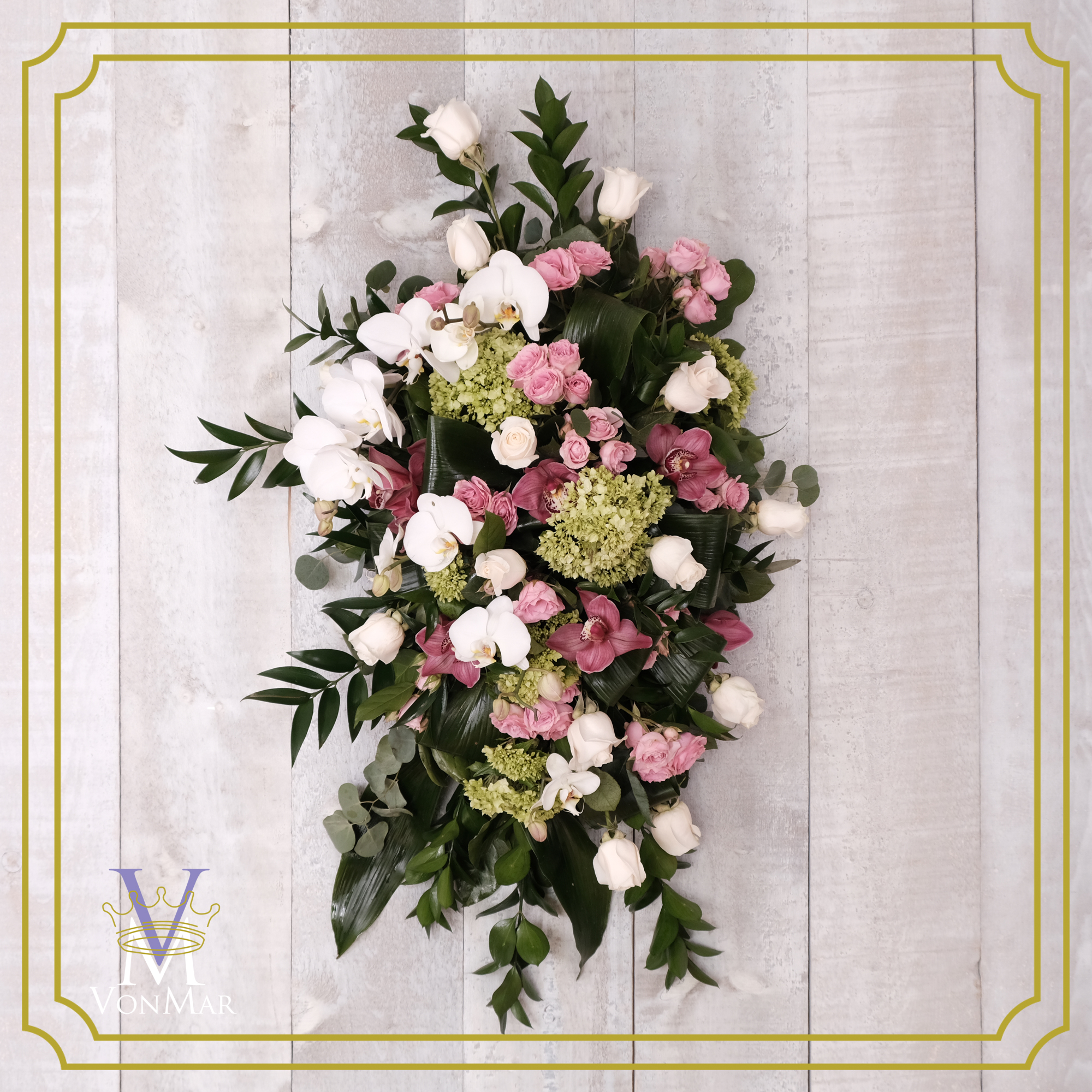 Hanging tribute spray in pink, white and greens