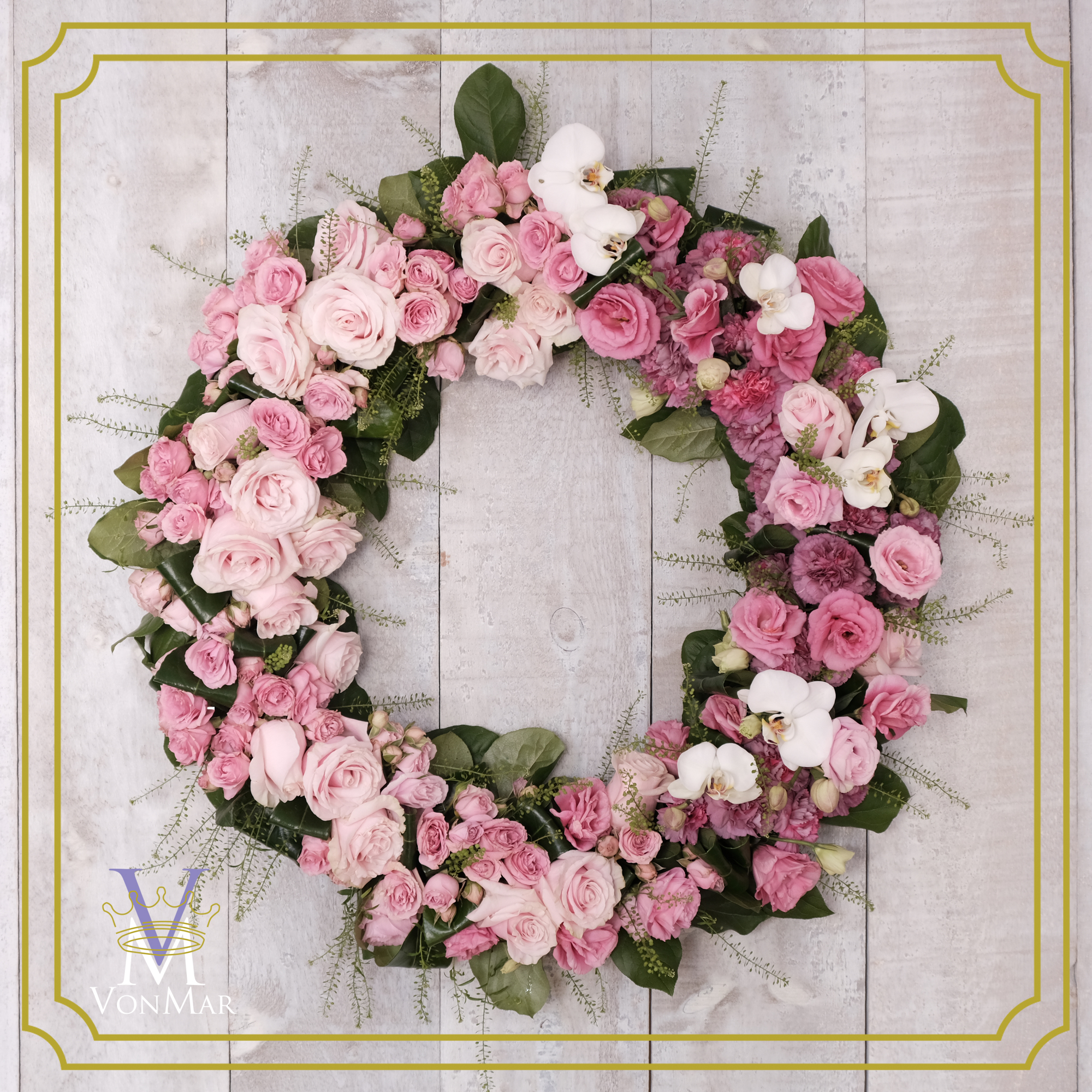 Tribute wreath in hues of pinks