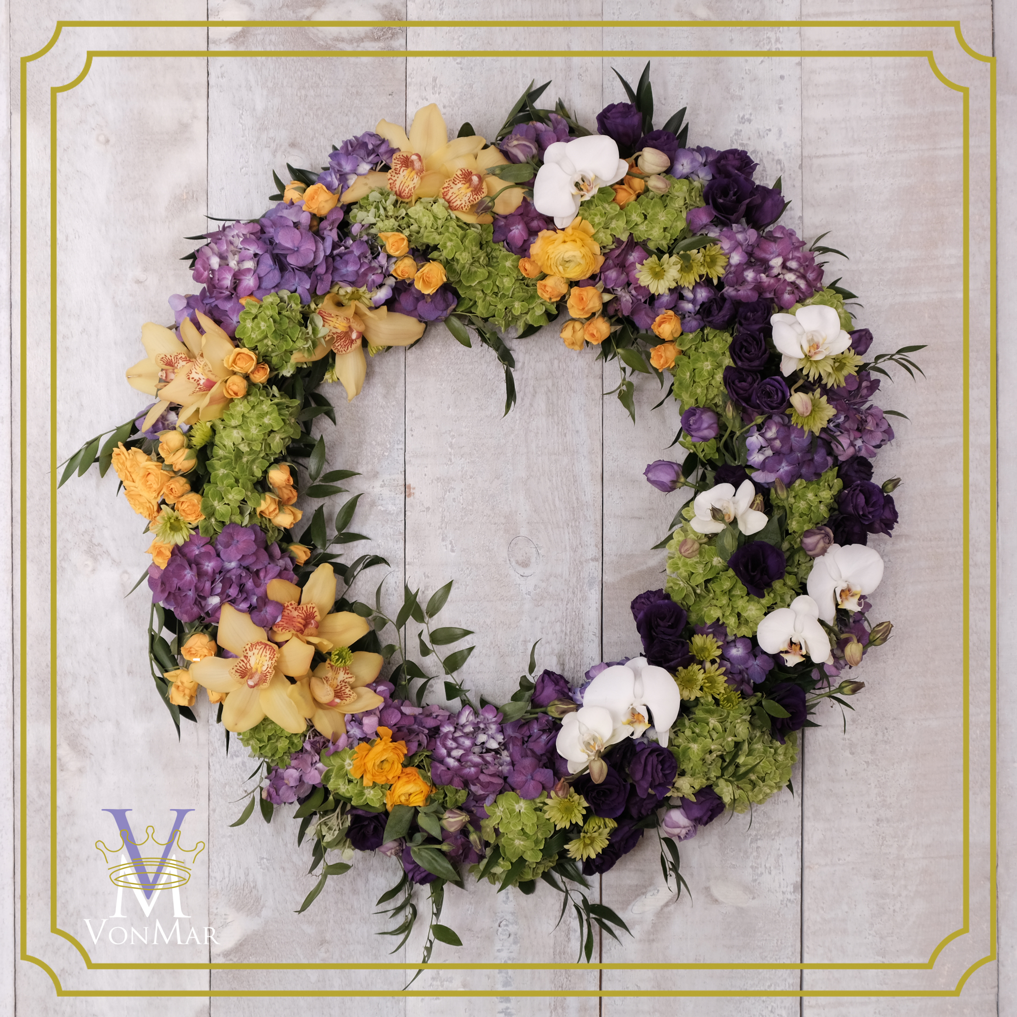 Tribute wreath in yellow, purple and green