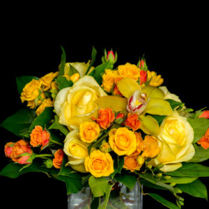 Bright yellow and orange bouquet in vase