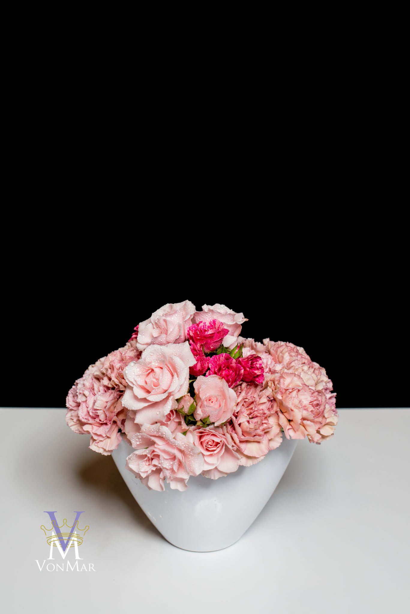 Carnation and spray rose mounded design