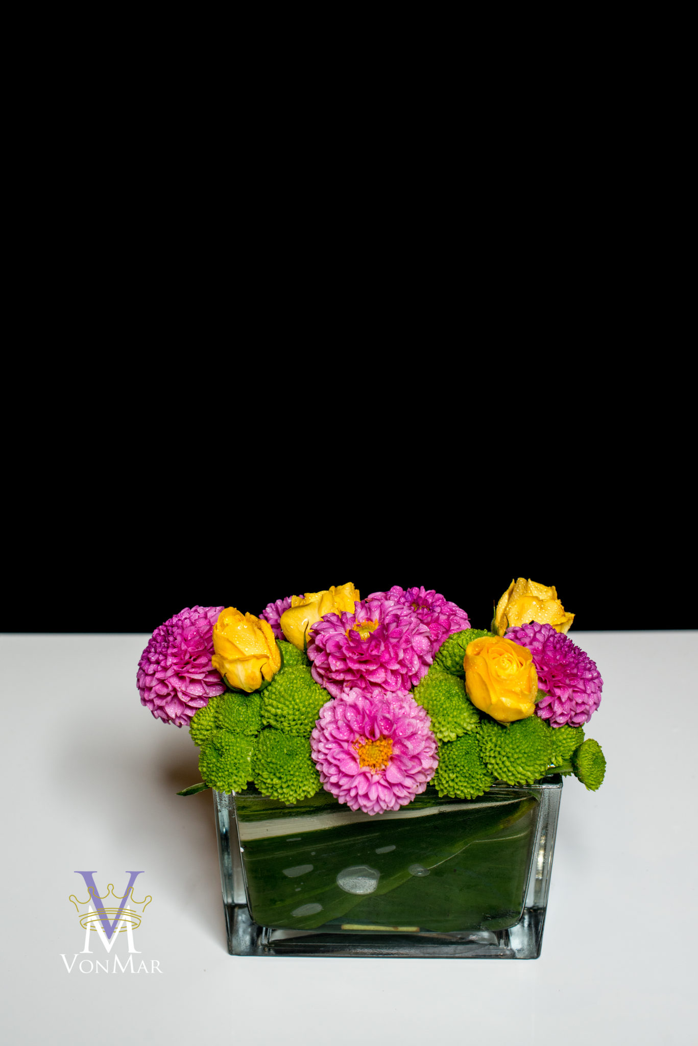 Pink Dahlia, yellow rose and button mums