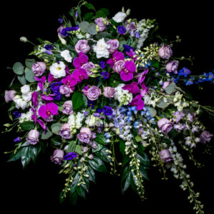 casket spray in purple, blue and white