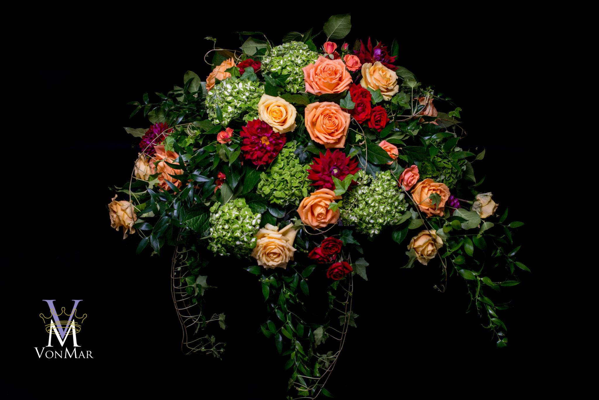 Casket spray green hydrangea yellow and orange roses