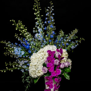 Delphinium, Hydrangea and purple roses