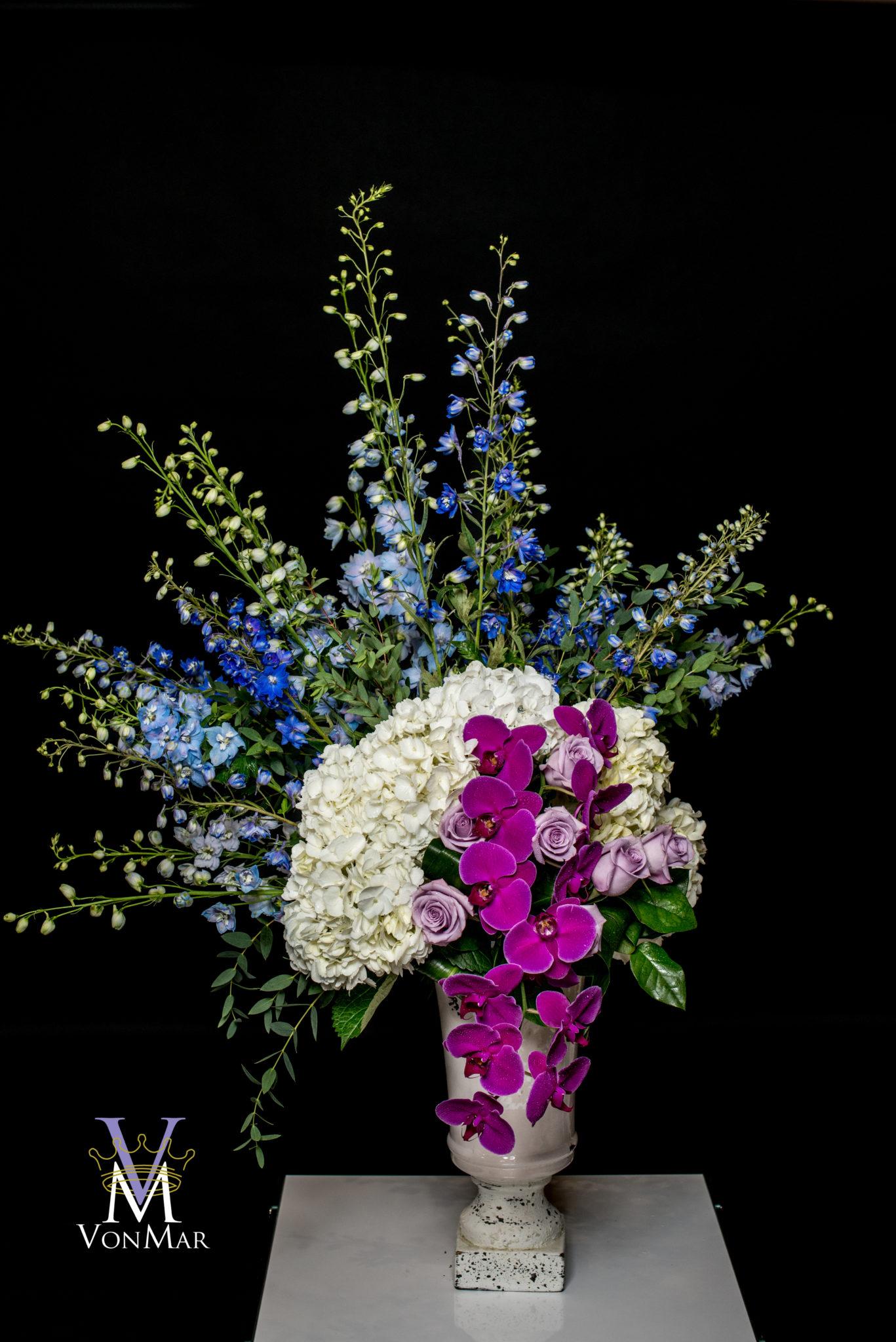 Delphinium, Hydrangea and purple roses
