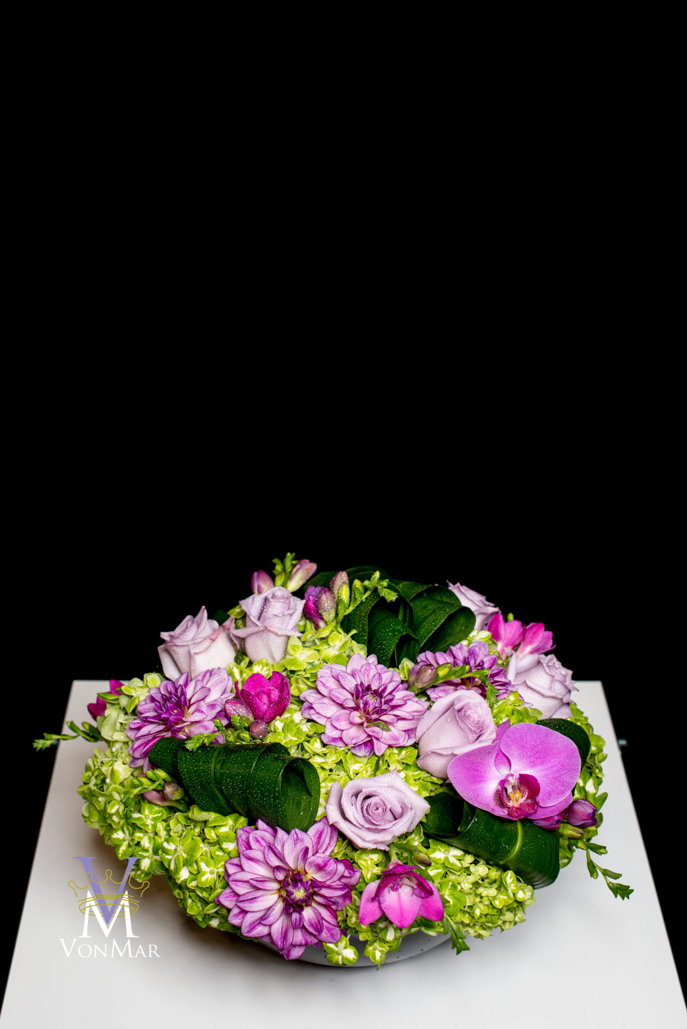 mounded green hydrangea, purple roses and dahlias